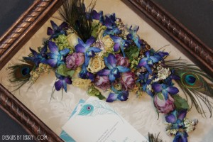 peacock feathers and orchids for preserved bridal bouquet